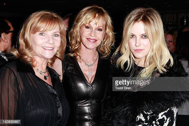 Carol Masterson Melanie Griffith and actress Riley Keough pose during an evening benefiting The New York Rescue Workers and Gulf Coast Detoxification...