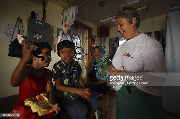 Carol Nagy a medical team leader for Medecins Sans Frontieres examines refugees aboard the rescue vessel MY Phoenix August 27 2015 Over 400 refugees...
