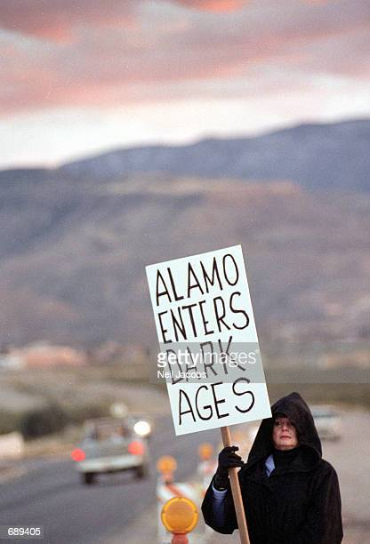 Carol Paul protests the burning of Harry Potter books outside the Christ Community Church December 30 2001 in Alamogordo New Mexico The churchs...