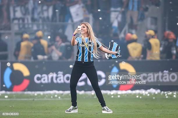 Carol Portaluppi daughter of Gremio's coach Renato Gaucho celebrates winning the championship Brazil 2016 Cup at Arena do Gremio on December 07 2016...