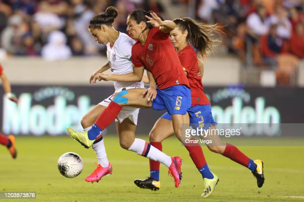 Carol Sanchez of Costa Rica and Carli Lloyd of USA fight the ball during the Group A game as part of the 2020 CONCACAF Women's Olympic Qualifying at...
