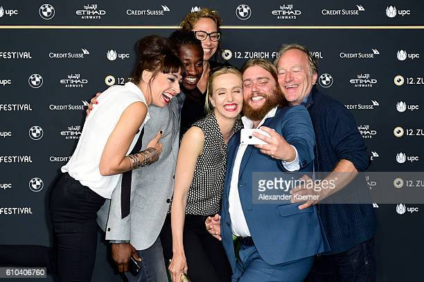 Carol Schuler, Eugene Boateng, Ursina Lardi, guest and Stefan Merki take a selfie as they attend the 'Im Nirgendwo' Photocall during the 12th Zurich...
