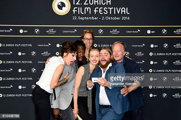 Carol Schuler Eugene Boateng Ursina Lardi guest and Stefan Merki take a selfie as they attend the 'Im Nirgendwo' Photocall during the 12th Zurich...