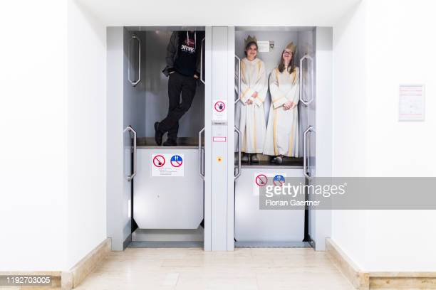 Carol singers use the paternoster of the Federal Ministry of Finance on January 09 2020 in Berlin Germany