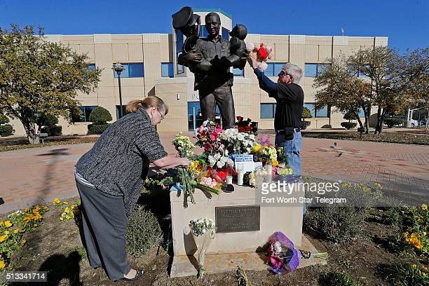 Carol Stoddard and Scott Thomas brought flowers and a teddy bear to the statue in front of the Euless Police Headquarters on March 2 2016 in Euliss...