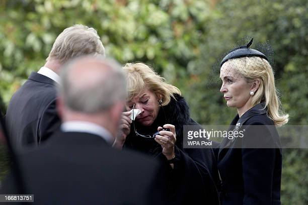 Carol Thatcher is consoled by brother Mark and his wife Sarah as they arrive at Mortlake Crematorium following the funeral of former British Prime...