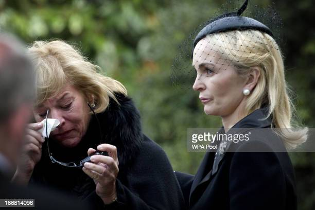 Carol Thatcher is consoled by sisterinlaw Sarah as they arrive at Mortlake Crematorium following the funeral of former British Prime Minister...
