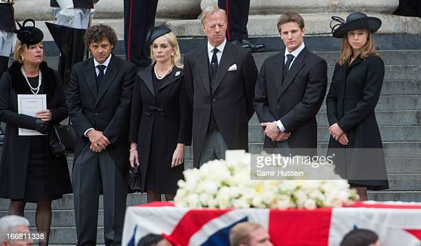 Carol Thatcher Marco Grass Sarah Thatcher Mark Thatcher Michael Thatcher and Amanda Thatcher watch the coffin of former British prime minister...
