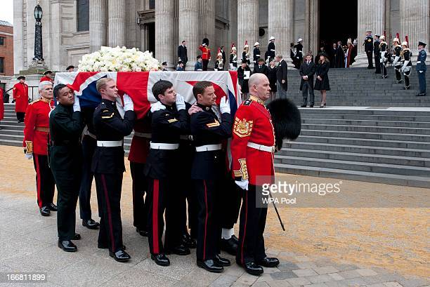 Carol Thatcher Marco Grass Sarah Thatcher Mark Thatcher Michael Thatcher and Amanda Thatcher watch as the coffin of former British Prime Minister...