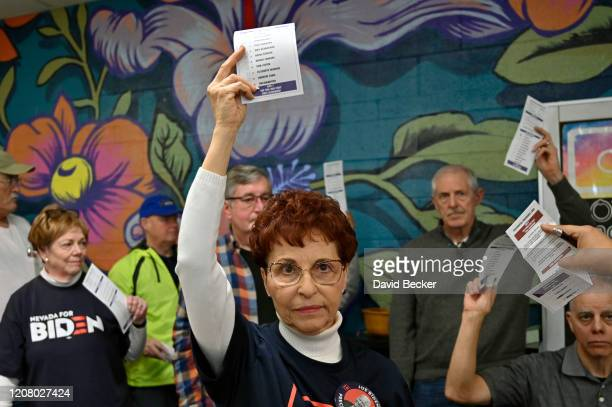 Carol Tipton raises her ballot in favor of Democratic presidential candidate former Vice President Joe Biden during a a Nevada Democratic caucus at...