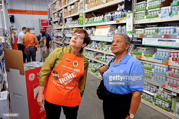 Carol Tome, chief financial officer of Home Depot Inc., left, speaks with customer Louise Cody at a Home Depot store in Atlanta, Georgia, U.S., on...