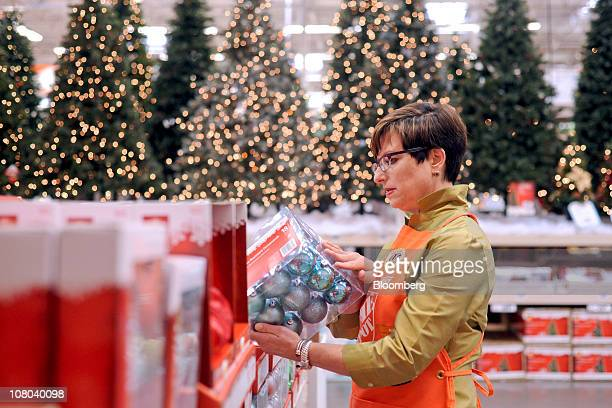 Carol Tome, chief financial officer of Home Depot Inc., looks at Christmas ornaments while posing for a photo at a Home Depot store in Atlanta,...