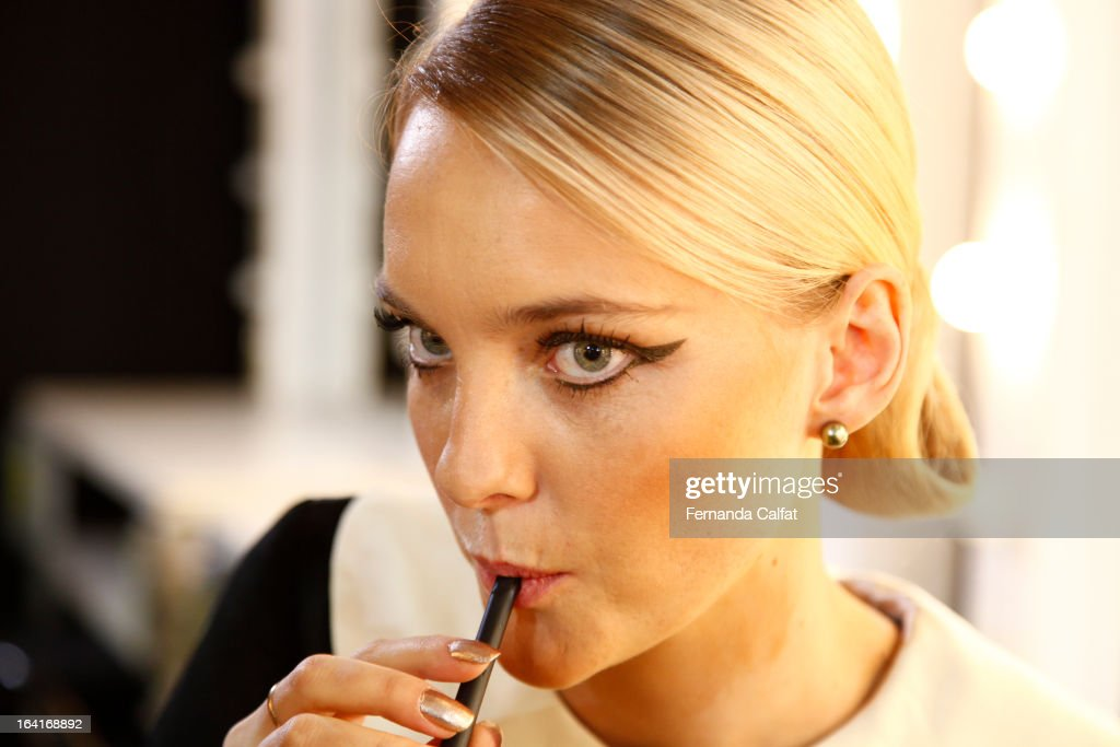 Carol Trentini prepares backstage at the Agua de Coco show during Sao Paulo Fashion Week Summer 2013/2014 on March 20, 2013 in Sao Paulo, Brazil.