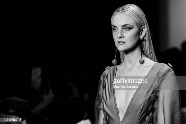 Carol Trentini walks the runway during the Agua de Coco show during Sao Paulo Fashion Week N46 SPFW Winter 2019 at ARCA on October 26 2018 in Sao...