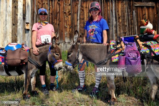 Carol Vonmichaelis and Linda Drain pose for a portrait with their burros Pepsi and Justin before running in the Pack Burro Race during the 70th...