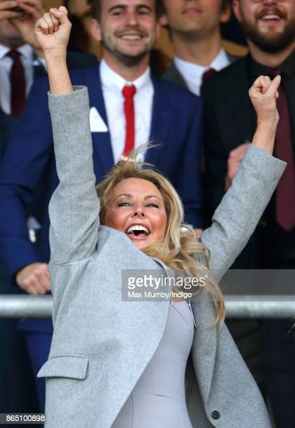Carol Vorderman cheers as she watches the racing at the QIPCO British Champions Day at Ascot Racecourse on October 21 2017 in Ascot England