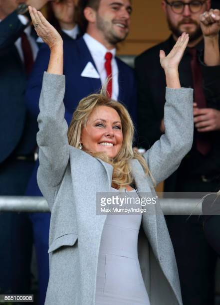 Carol Vorderman cheers as she watches the racing at the QIPCO British Champions Day at Ascot Racecourse on October 21, 2017 in Ascot, England.
