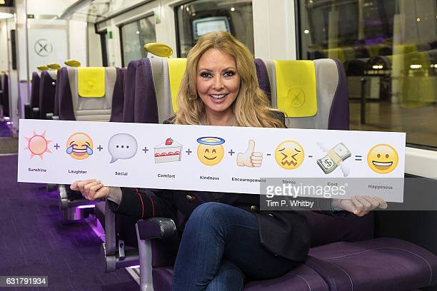 Carol Vorderman poses for a photo with a formula for happiness expressed in emojis to help cheer passengers on 'Blue Monday' and to highlight the...