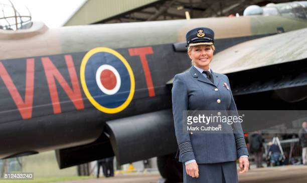Carol Vorderman poses in front of a Lancaster bomber during a visit to The Battle Of Britain Memorial Flight to mark it's 60th anniversary at RAF...