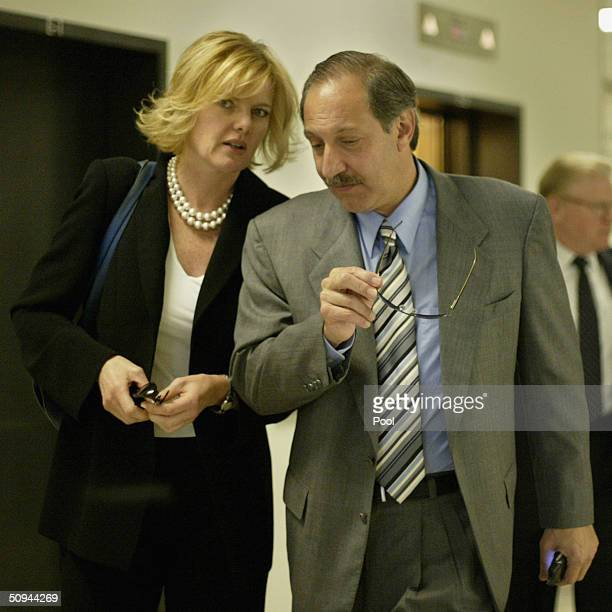 Carol Welsman talks with Scott Peterson's attorney Mark Geragos as they leave the San Mateo County courthouse in Redwood City, California on...