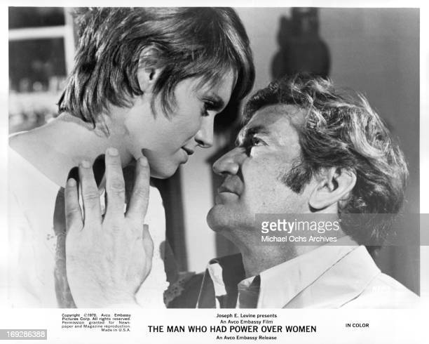 Carol White and Rod Taylor looking into each other's eyes in a scene from the film 'The Man Who Had Power Over Women' 1970