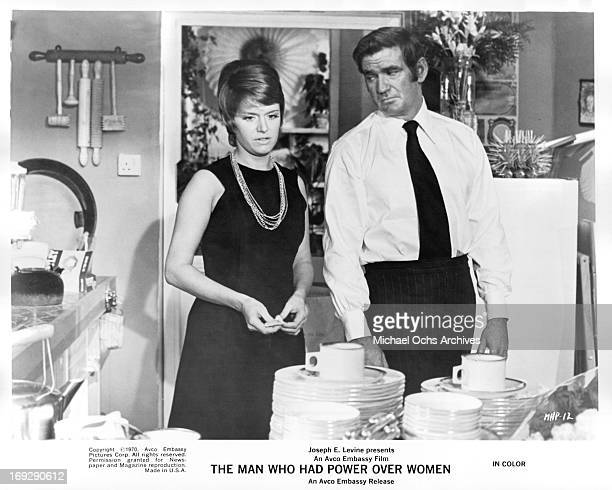Carol White in the kitchen with Rod Taylor in a scene from the film 'The Man Who Had Power Over Women' 1970