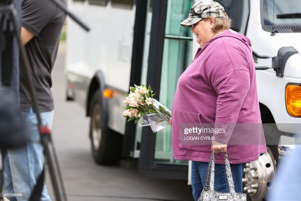 Carol Wyatt arrives at the Billy Graham Library in Charlotte, North Carolina to pay respects hours after the announcement that Rev. Graham passed away in his home in Montreat, NC February 21, 2018. US presidents from Jimmy Carter to Donald Trump led the chorus of tributes Wednesday to the influential evangelist Billy Graham, a spiritual advisor to a dozen American leaders who has died at age 99. / AFP PHOTO / Logan Cyrus for AFP / Logan Cyrus