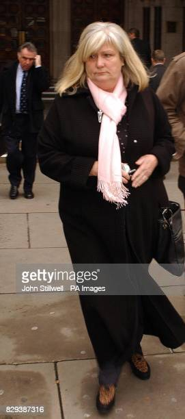 Carol WynnJones leaves the High Court in London with her husband David in the background on the telephone A High Court judge began his day watching a...
