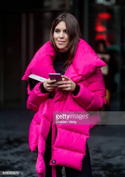 Carola Bernard wearing a pink down feather jacket outside Acne on March 4 2017 in Paris France