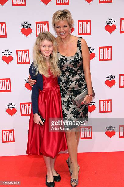 Carola Ferstl and her daughter Lilly attend the Ein Herz Fuer Kinder Gala 2014 at Tempelhof Airport on December 6 2014 in Berlin Germany