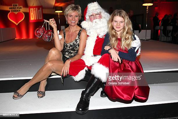 Carola Ferstl and her daughter Lilly attend the Ein Herz fuer Kinder Gala 2014 after show party at Tempelhof Airport on December 6 2014 in Berlin...