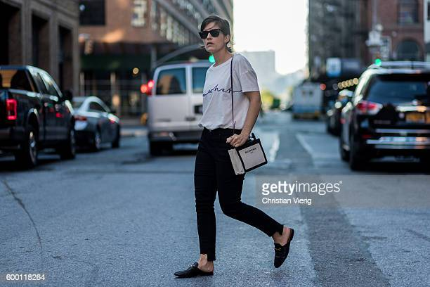 Carola Pojer wearing a white tshirt Balenciaga bag black denim jeans and Gucci loafers outside R13 on September 7 2016 in New York City