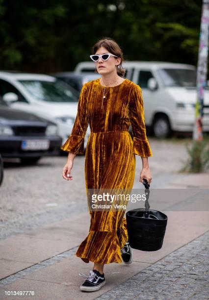 Carola Pojer wearing velvet dress is seen outside Stine Goya during the Copenhagen Fashion Week Spring/Summer 2019 on August 8 2018 in Copenhagen...