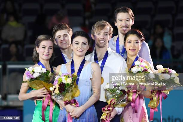 Carolane Soucisse and Shane Firus of Canada Kaitlin Hawayek and JeanLuc Baker of the USA Kana Muramoto and Chris Reed of Japan pose on the podium...
