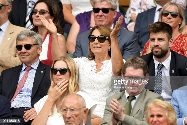 Carole and Michael Middleton and Gerard Pique sit in the royal box on day three of the Wimbledon Tennis Championships at the All England Lawn Tennis...