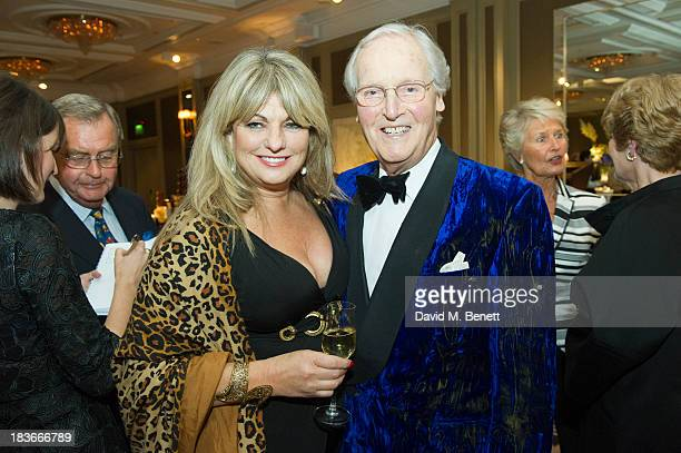 Carole Ashby and Nicholas Parsons attend Nicholas Parsons 90th birthday party at the Churchill Hotel on October 8 2013 in London England