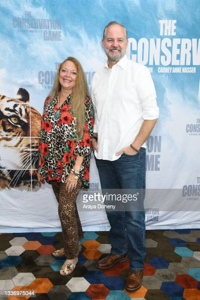 """Carole Baskin and Michael Webber attend the Los Angeles theatrical premiere of """"The Conservation Game"""" on August 28, 2021 in Santa Monica, California."""