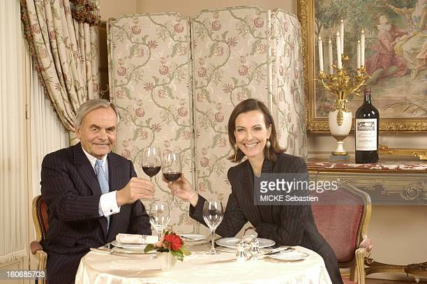 Carole BOUQUET, Ambassador of Chateau Fombrauge, clinking glasses with Bernard MAGREZ seated at Ritz PARIS.