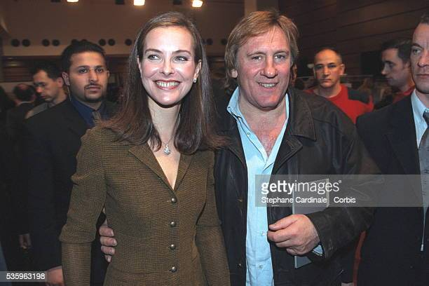Carole Bouquet and G{rard Depardieu both attended the Chanel FallWinter 2001/2002 pretaporter show that was designed by Karl Lagerfeld