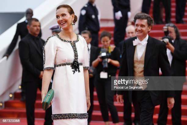 Carole Bouquet and Philippe Sereys de Rothschild attend the 70th Anniversary of the 70th annual Cannes Film Festival at Palais des Festivals on May...