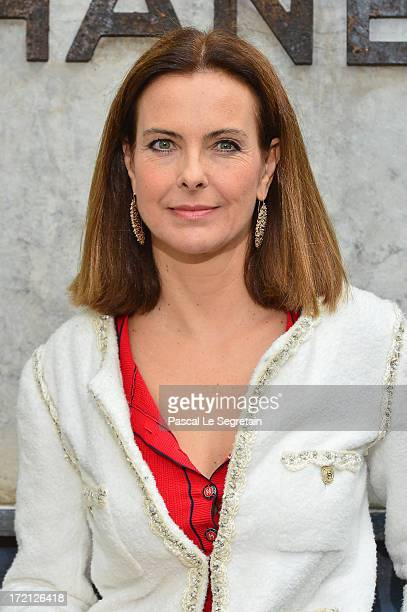 Carole Bouquet attends the Chanel show as part of Paris Fashion Week HauteCouture Fall/Winter 20132014 at Grand Palais on July 2 2013 in Paris France