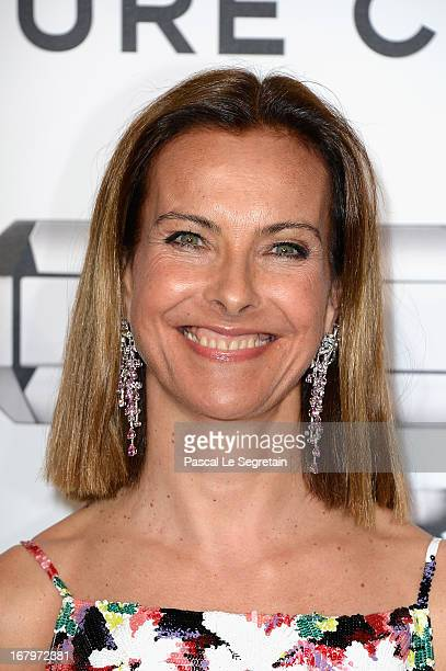 Carole Bouquet poses during a photocall for 'N°5 Culture Chanel' exhibition at Palais De Tokyo on May 3 2013 in Paris France