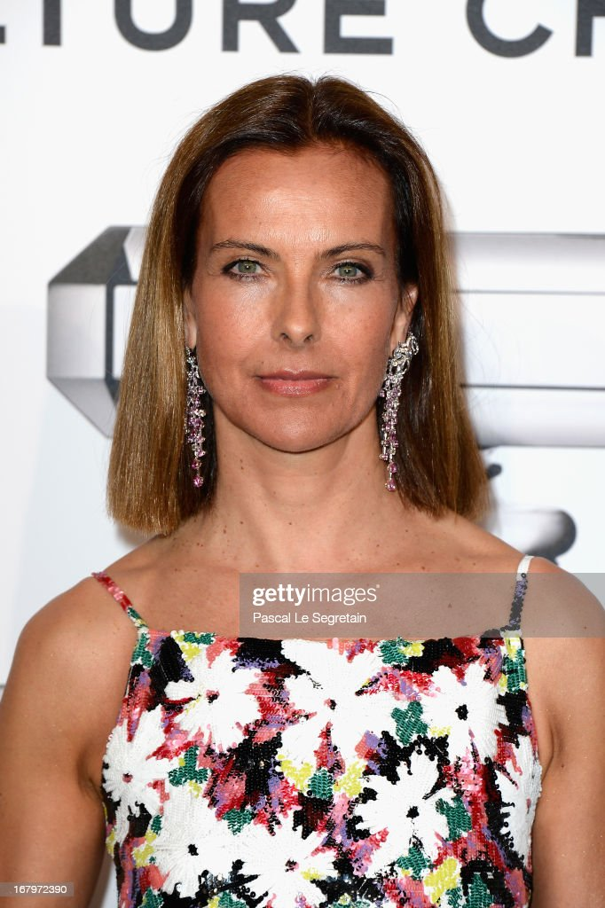 Carole Bouquet poses during a photocall for 'N°5 Culture Chanel' exhibition at Palais De Tokyo on May 3, 2013 in Paris, France.