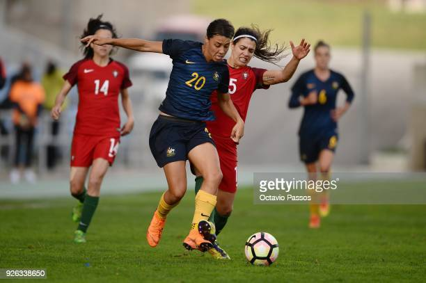 Carole Costa of Portugal competes for the ball with Sam Kerr of Australia during the Women's Algarve Cup Tournament match between Portugal and...