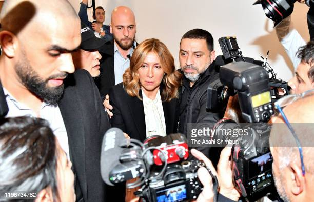 Carole Ghosn wife of former chairman of Nissan and Mitsubishi Motors Carlos Ghosn is surrounded by security staffs as she leaves after a press...