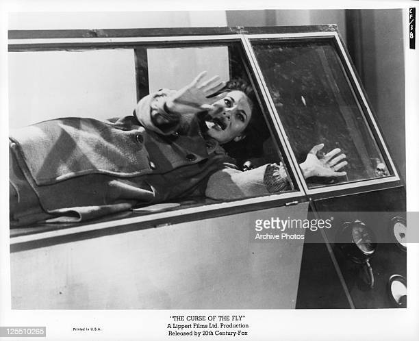 Carole Gray tries to escape from an infernal machine which creates monsters in a scene from the film 'The Curse Of The Fly' 1965