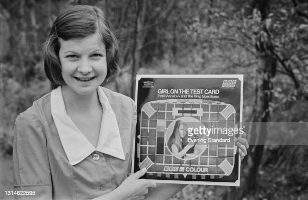 Carole Hersee holds up the LP 'Girl on the Test Card' by Pete Winslow And The King Size Brass, UK, 29th March 1974. Hersee appeared as the girl on...