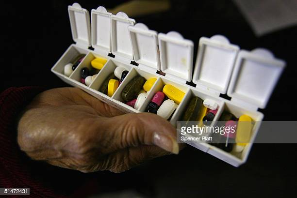 Carole Jaquez displays a box of pills for her asthma and high blood pressure condition purchased in Canada at a 589% savings October 12 2004 in New...