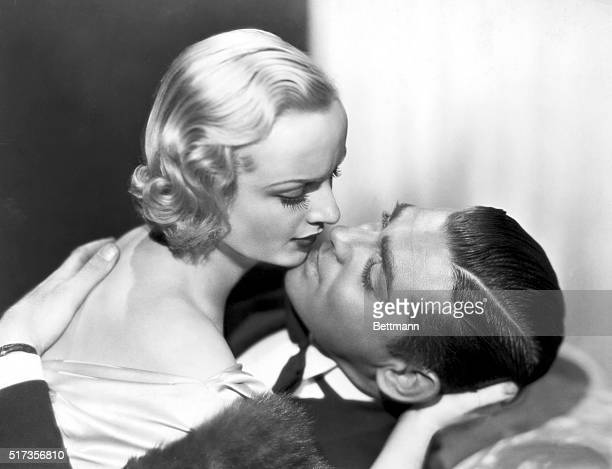 Carole Lombard and Clark Gable prepare for a screen kiss in a scene from the film No Man of Her Own Move still 1932