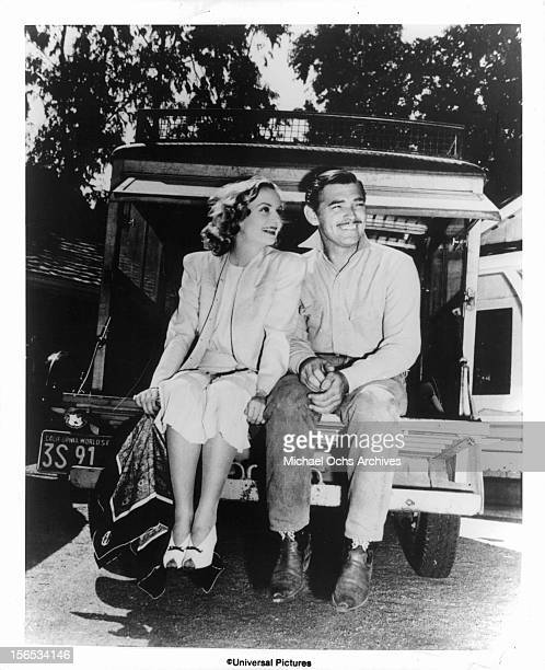 Carole Lombard and Clark Gable sit in the back of a vehicle during a break from shooting a film Circa 1940